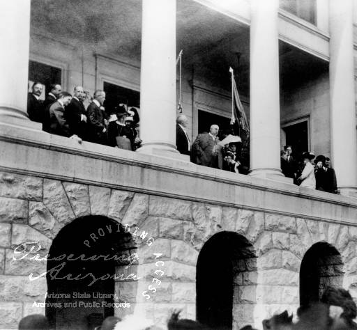 Photograph of Governor George W.P. addressing an audience from the State Capitol in Phoenix (Ariz.) on Statehood Day, February 14, 1912